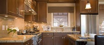 blue kitchen cabinets with granite countertops how the color of your granite countertops affects you