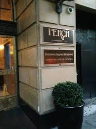 entrance of the building where the restaurant perch is located