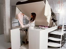 space saving double bed smart space saving bed hides a walk in closet underneath intended