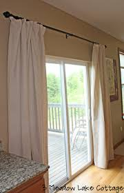 sliding glass door drapes how to hang curtains on sliding doors