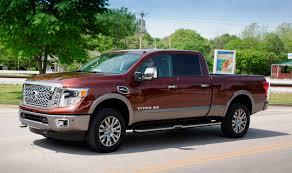 custom nissan cummins nissan titan xd platinum reserve v 8 decked in luxury truck