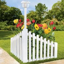 Solar Powered Fence Lights - white wood corner fence with solar powered light garden