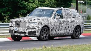 rolls royce cullinan render rolls royce ceo slams bentley bentayga as audi q7 in camouflage
