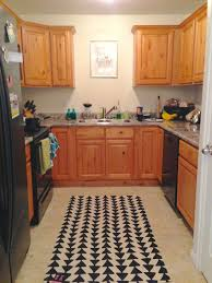 sumptuous triangle shape arrows pattern kitchen rugs on ceramic sumptuous triangle shape arrows pattern kitchen rugs on ceramic floors tiled with u shape walnut wooden kitchen cabinet set as inspiring small kitchen