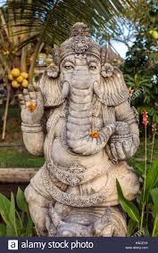 ganesha statue with flowers in the garden stock photo