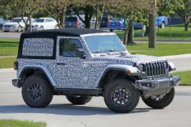 camo jeep yj spyshots 2018 jeep wrangler jl reveals grille and headlights