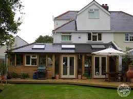 completed green oak timber framed extension by carpenter oak ltd