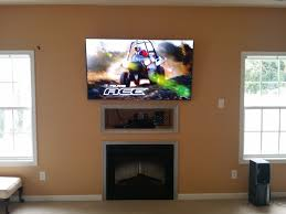 image of small mounting tv above fireplace