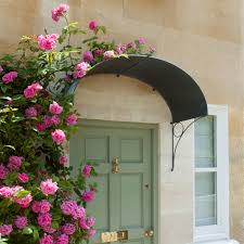 climbing pink roses over a gentle ellipse front door canopy