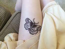 black butterfly on leg