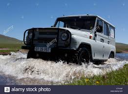 uaz jeep russian jeep uaz 469 ford river in mongolia on steppe mongolia