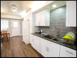 white cabinets with grey countertops kitchen grey cabinets subway