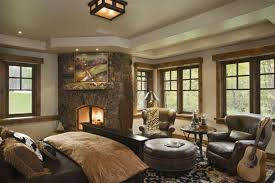 comfortable bedroom traditional rustic fireplace throughout large