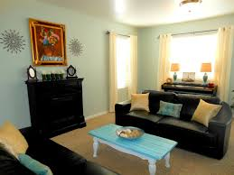 great black leather cool couches with rustic teal coffee table as