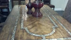 luxury dining room furniture table with stone inlay top and iron work