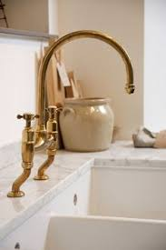 Bathroom And Kitchen Faucets Delta Trinsic Faucet In Chagne Bronze Kitchen By Design