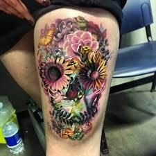 feminine skull on hip skull tattoos