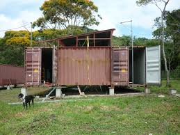 cutting metal making a wall a shipping container house in panama