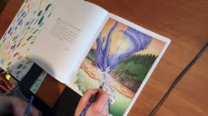christopher paolini colors a page in his new book the official