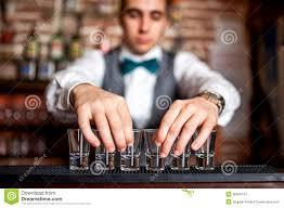 barman preparing shots for cocktail party royalty free stock