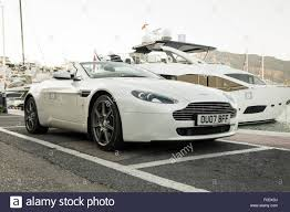 aston martin sports car aston martin vantage v8 sports car parked in front of luxury