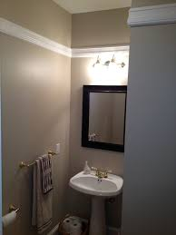 home addition installed chair rail in high ceiling powder room