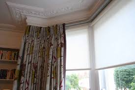 curtains behind blinds decorate the house with beautiful curtains