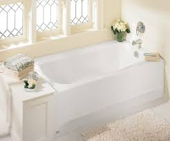 bathroom cozy white bathroom tub design in laminated wooden case beautiful white flower in the corner of bright white bathroom tub combined with comfort white