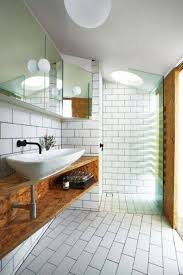narrow bathroom ideas with subway tiles and white globe ceiling