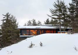 ian macdonald hides ontario island cottage within a forest
