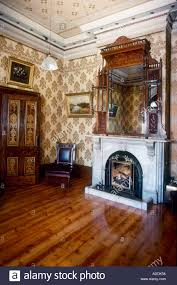 white marble victorian fireplace with mirror above and stencilled