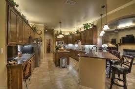 floor and decor granite countertops mediterranean kitchen with pendant light built in bookshelf