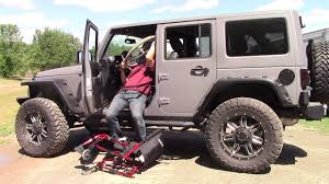 jeep lifted glide u0027n go transfer lift seat in lifted jeep wrangler sahara
