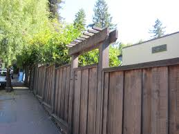 simple fence with alt boards u0026 trellis above gate that could