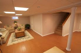 basement cool basement ceiling ideas with wooden floor and cream