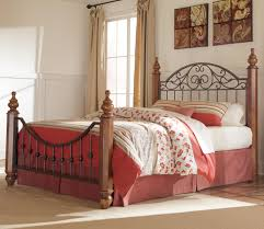 Poster Bed by Signature Design By Ashley Wyatt Queen Octagon Poster Bed Del
