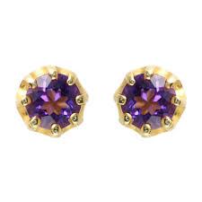 gold stud earrings uk 9ct yellow gold claw set amethyst stud earrings jewellery from