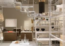 muji shelving units combine to form fumihiko sano u0027s installation