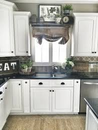 Decorating The Top Of Kitchen Cabinets Mediterranean Style Kitchens Decorating Kitchens And Kitchen Decor