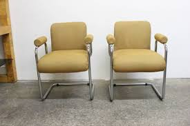 pair of occasional chairs by guido faleschini for mariani for sale