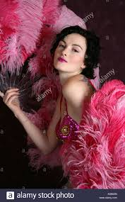 burlesque feather fans burlesque performer with pink ostrich feather fans stock photo