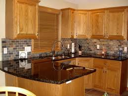 charming oak cabinets with granite countertops and kitchen