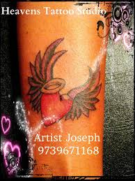 heart with wings tattoo on wrist heavens tattoo studio bangalore