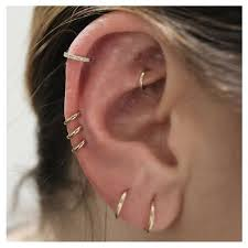 ear piercing hoop seven different rings all this ear including a diamond