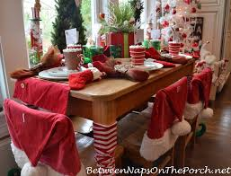santa hat chair covers the kid s table at christmastime