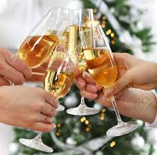 or new year celebration holding glasses of