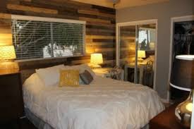 how to install a diy wooden pallet wall easy inexpensive