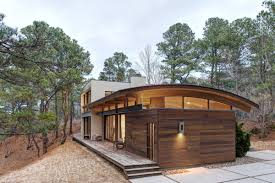 Metal Roof Homes Pictures by Contemporary Forest House With Curved Metal Roof