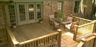 adding a deck patio or outdoor kitchen today s homeowner with