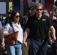 is meghan markle sending messages through her clothes about status